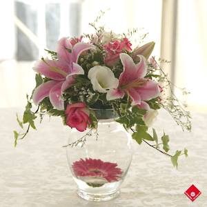 Wedding flowers in a decorative vase for the wedding party.