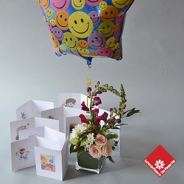 Happy Face Balloon and a greeting card to get your message across.