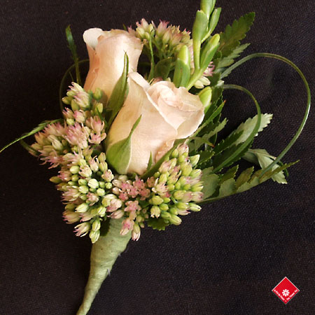 A women's rose corsage for a Montreal wedding - The Flwoer Pot.