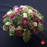 Wedding centerpiece made of fresh garden flowers.