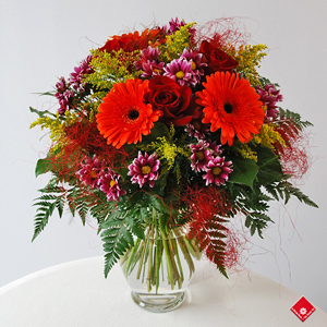 Assorted flowers in vase.
