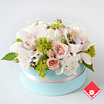 Pastel flowers in a blue box