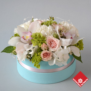 Pastel flowers in a blue gift box