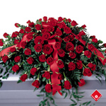 Red roses in a casket spray for Montreal delivery to a funeral parlour.