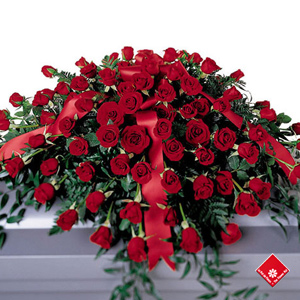 Red roses in a casket spray for Montreal delivery by The Flower Pot to a funeral parlour
