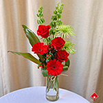 Red flower bouquet with red roses and red gerbera.