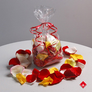 Fresh rose petals in assorted colors.
