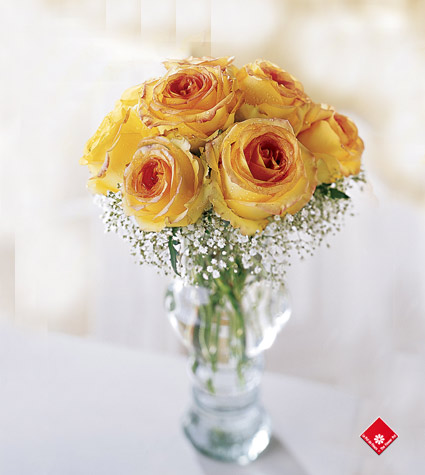Nine yellow roses in a vase.