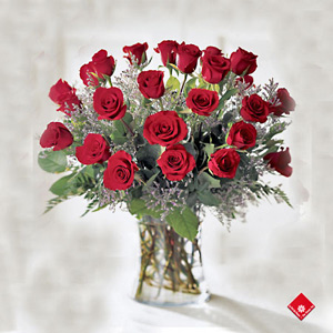 Valentine gift of two dozen red roses in a vase.