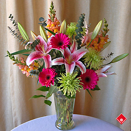 Versatile flowers in a vase for Montreal delivery.