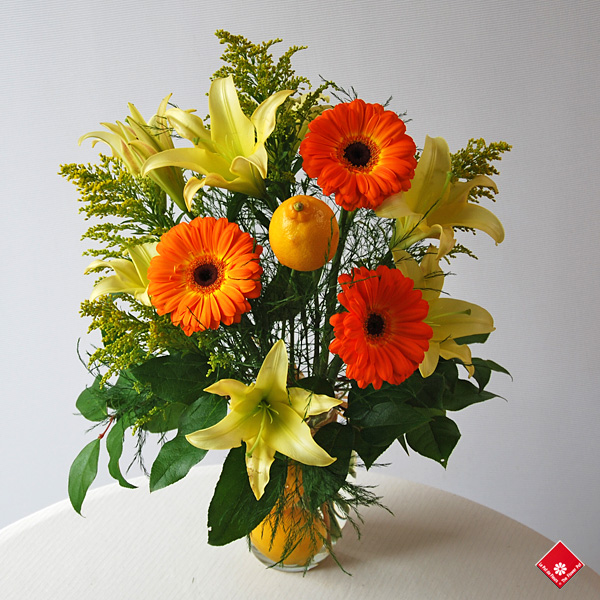 Summer bouquet of gerberas and lemons.