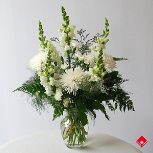 Sympathy vase of white snapdragons.and chrysantemums