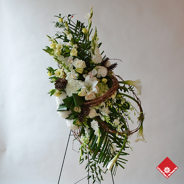 Funeral flower spray of elegant white flowers will express the sympathy you feel.