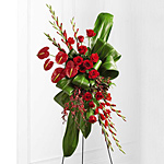 Express your sympathy with a funeral service floral standing spray with anthuriums, roses and orchid