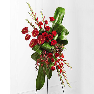 Express your sympathy with a funeral service floral standing spray with anthuriums, roses and orchids.