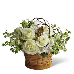 Garden basket of white colored blooms.