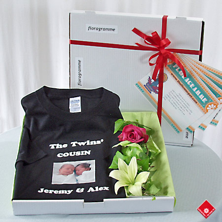Custom photo tshirt in a pizza box with the flower of the day.