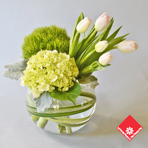 Tulips and more in glass bowl from The Flower Pot.