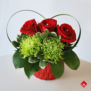 Three red roses and more from The Flower Pot