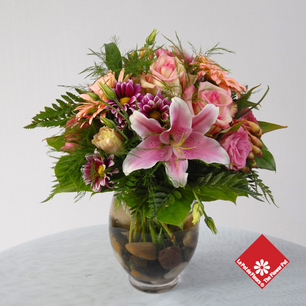 Assorted pink flowers in vase.