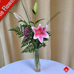 Oriental lily bouquet in a glass vase - The Flower Pot.