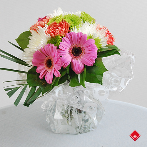 Hand tied bouquet in water from The Flower Pot in Montreal