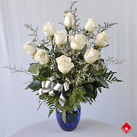 White Roses in a blue vase for delivery in Montreal by The Flower Pot.