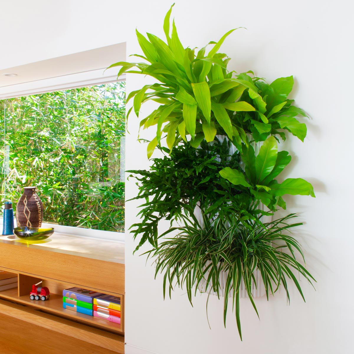 Make your plants seem like they are floating with white wall planters that match the white of your wall.
