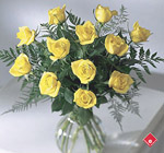 One dozen yellow roses in a vase.