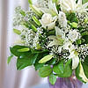 Sympathy gift of white flowers in a glass vase.