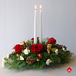 Classic red and white christmas candle centerpiece.