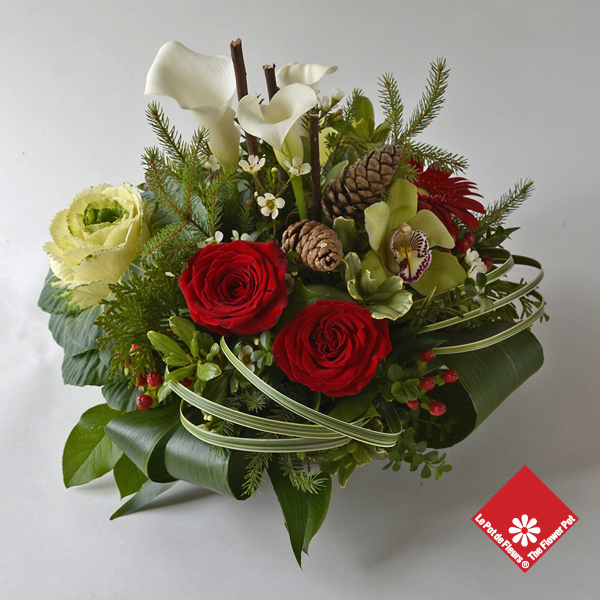 Christmas centerpiece with roses and orchids