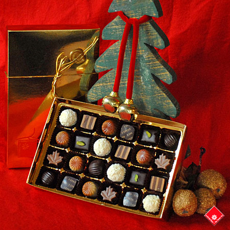Handmade Christmas chocolate in a decorative gift box.