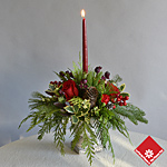 Christmas arrangement with roses and candle.